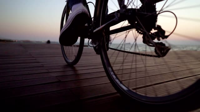 cycling by the sea - pedal stock videos & royalty-free footage
