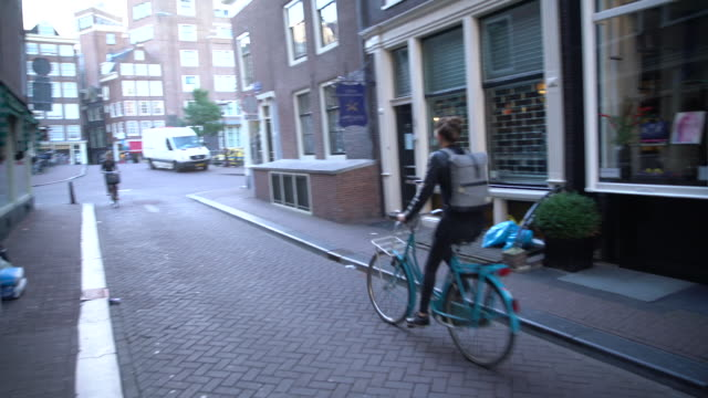cycling down alley - netherlands stock videos and b-roll footage