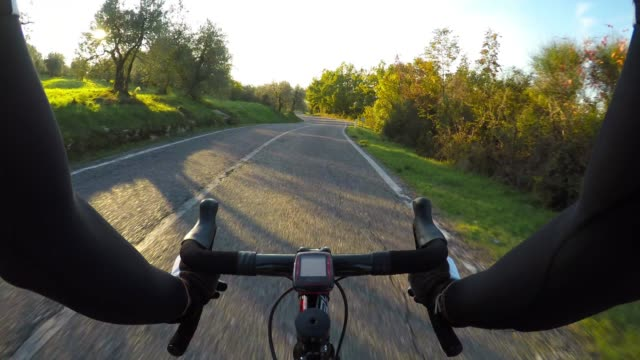 cycling downhill in chianti region, tuscany. pov - tuscany stock videos and b-roll footage
