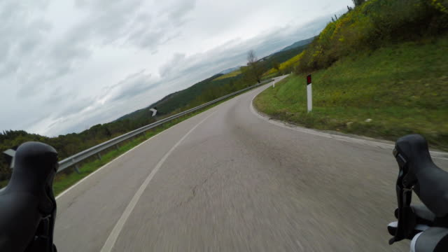 cycling downhill on a racing bike - racing bicycle stock videos and b-roll footage