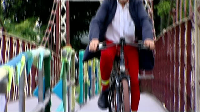 government announces major cycling investment scheme; england: bristol: ext reporter cycles along past cathedral cyclists along cycle path over... - stencil stock videos & royalty-free footage