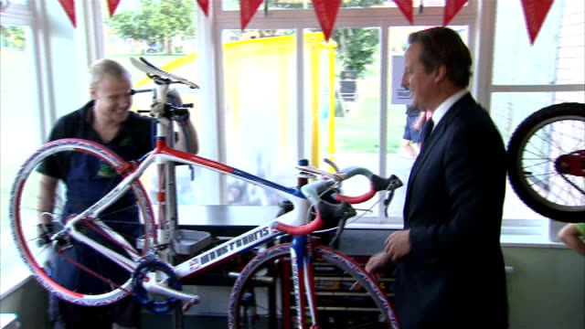 government announces major cycling investment scheme; hoy / cameron, hoy and pendleton / cameron looking at racing bike / cameron / cameron talking... - hoy stock videos & royalty-free footage