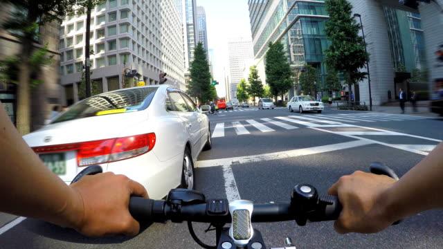 cycling in marunouchi, tokyo - marunouchi stock videos & royalty-free footage