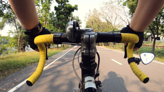 pov : cycling in public park - cycling event stock videos & royalty-free footage
