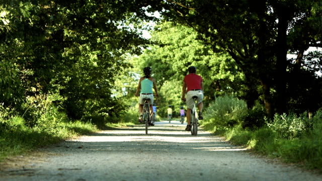 hd: cycling in the countryside - cycling helmet stock videos & royalty-free footage