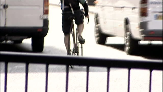 lorries without cycle safety devices to be banned from london / t21111406 int lorry safely overtaking cyclist various of cyclists along through city... - overtaking stock videos and b-roll footage
