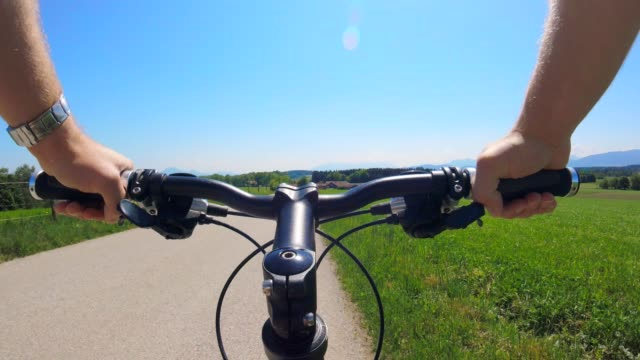 pov: cycling on a country road early summer - sports glove stock videos & royalty-free footage