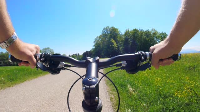 pov: cycling on a country road early summer - helmet stock videos & royalty-free footage