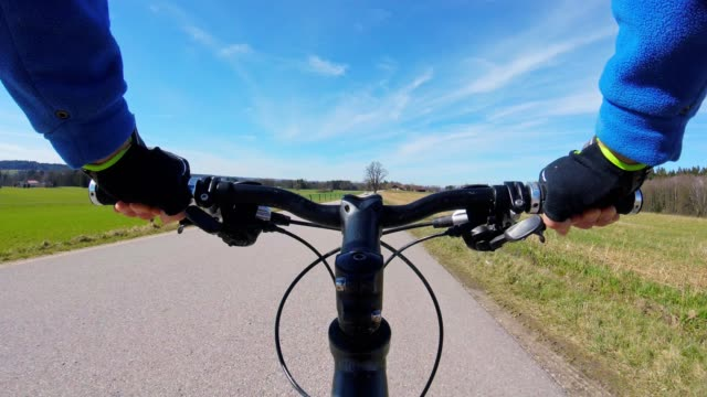 POV: Cycling on a country road in spring