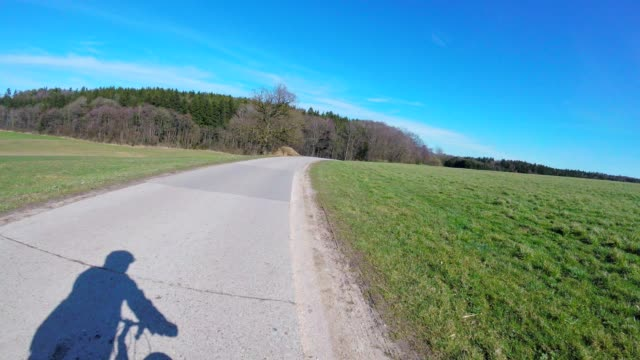 pov: cycling on a country road in spring - sports helmet stock videos & royalty-free footage