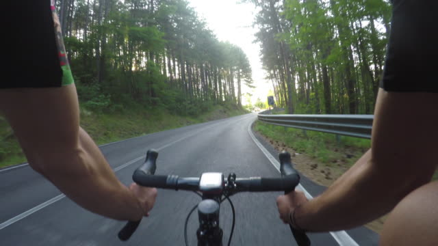 cycling on a summer afternoon. pov - racing bicycle stock videos and b-roll footage