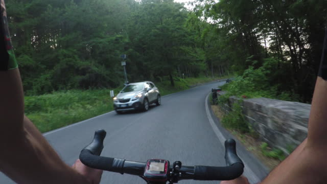 cycling on summer. pov - racing bicycle stock videos and b-roll footage