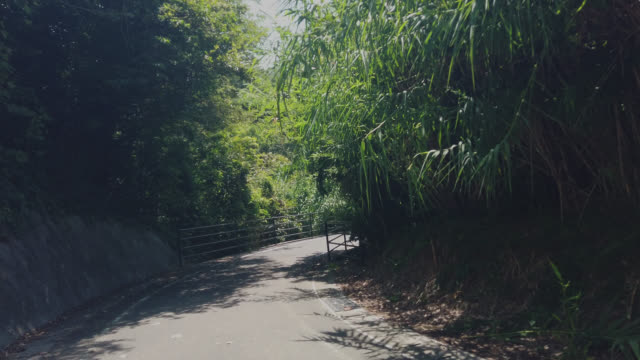 cycling on the shimanami kaido bicycle route, innoshima island , japan - onomichi hiroshima stock videos and b-roll footage