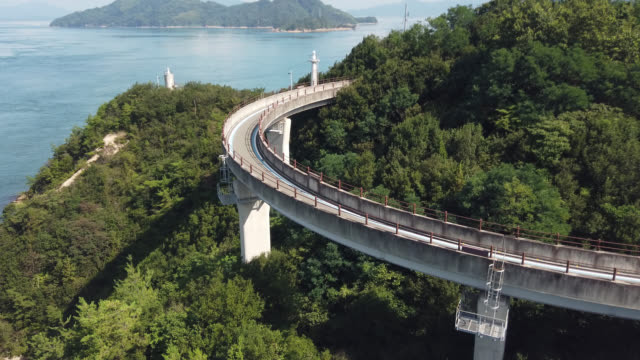 cycling on the shimanami kaido bicycle route, japan , - bicycle trail outdoor sports stock videos & royalty-free footage