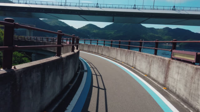 cycling on the shimanami kaido bicycle route, japan - onomichi hiroshima stock videos and b-roll footage