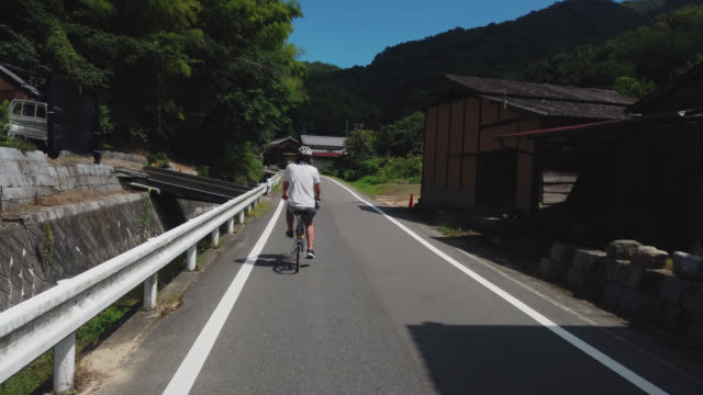 cycling on the shimanami kaido bicycle route, japan - nishiseto expressway stock videos & royalty-free footage