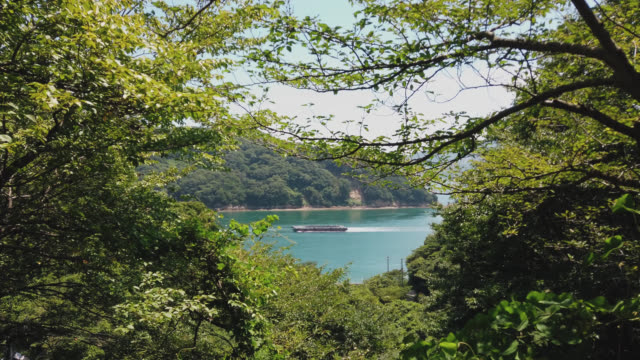 cycling on the shimanami kaido bicycle route, omishima island , rest spot,  japan - onomichi hiroshima stock videos and b-roll footage