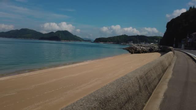 cycling on the shimanami kaido bicycle route, oshima island , japan - nishiseto expressway stock videos & royalty-free footage