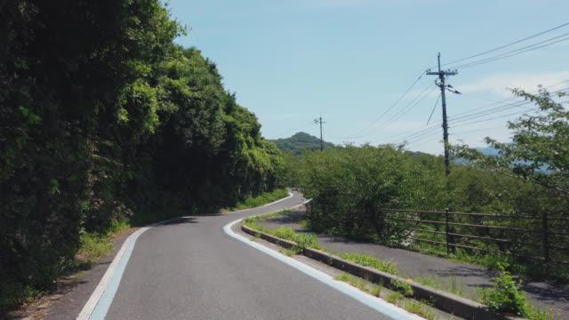 cycling on the shimanami kaido bicycle route, oshima island , japan - onomichi hiroshima stock videos and b-roll footage