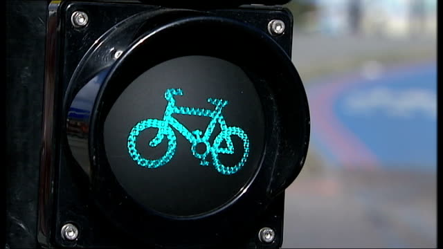 Cycling safety concerns mean people are making fewer journeys by bike Bow Roundabout Reporter to camera Low angle view cyclist along then van and...