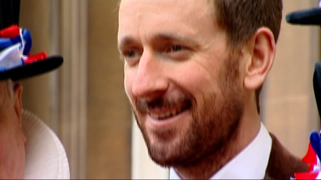 sir bradley wiggins receives knighthood / concerns about cycle safety in london england london buckingham palace ext knighthood medal tilt up sir... - リチャード・パロット点の映像素材/bロール