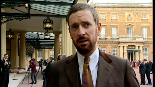 sir bradley wiggins receives knighthood / concerns about cycle safety in london; england: london: buckingham palace: wiggins interview sot knighthood... - wife stock videos & royalty-free footage