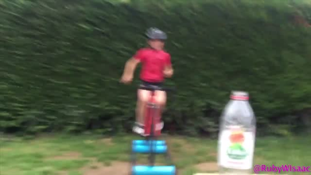 //www.itv.com/news/central//meet-the-9-year-old-hollywood-biking-star-from-kettering/ cycling star ruby isaac smashed the #bottlecapchallenge from... - bicycle stock videos & royalty-free footage