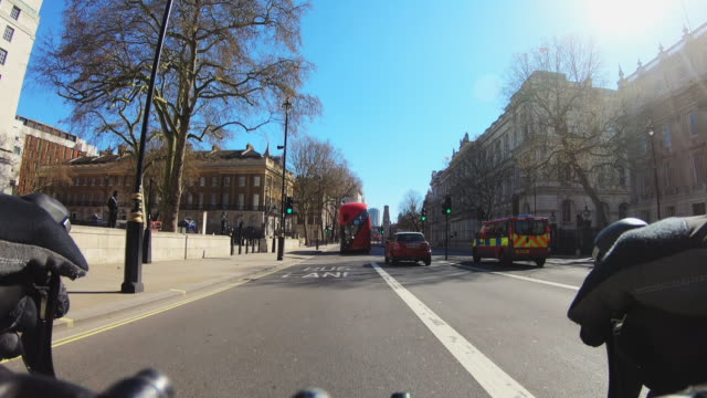 cycling pov through empty streets of london during the lockdown - whitehall london stock videos & royalty-free footage
