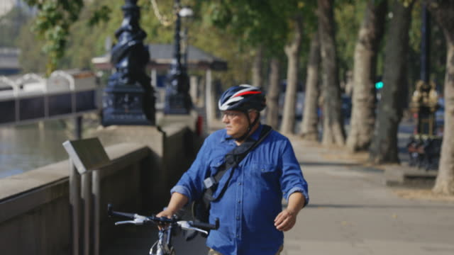 cycling through the city - riverbank stock videos & royalty-free footage