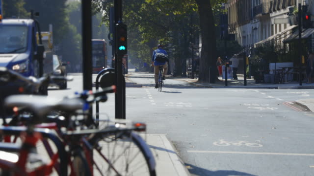 cycling through the city - traffic light stock videos & royalty-free footage