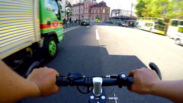 cycling to tokyo station-4k- - marunouchi stock videos & royalty-free footage