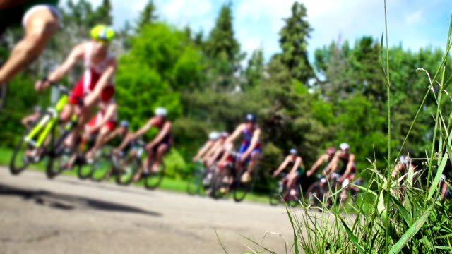 cycling triathlon competitive road race. - triathlon stock videos & royalty-free footage
