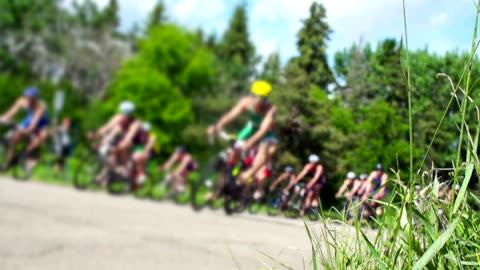 vídeos y material grabado en eventos de stock de ciclismo triatlón competitiva road race. - portería artículos deportivos