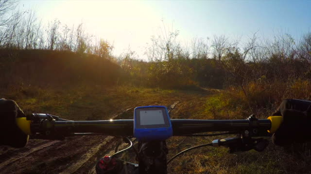 pov cycling uphill on a muddy road. - uphill stock videos & royalty-free footage