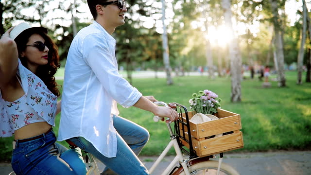Cyclist and his girlfriend enjoy in spring ride