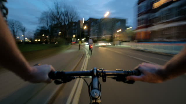 stockvideo's en b-roll-footage met cyclist pov at dusk travelling rapidly along residential streets in north london - verkeersbord