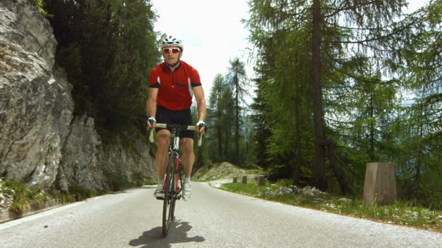 cyclist cycling on the mountain road. - cardiovascular exercise stock videos & royalty-free footage