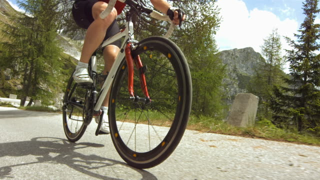 cyclist cycling on the mountain road. - wheel stock videos & royalty-free footage