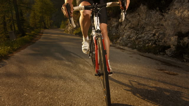 Cyclist cycling on the mountain road.