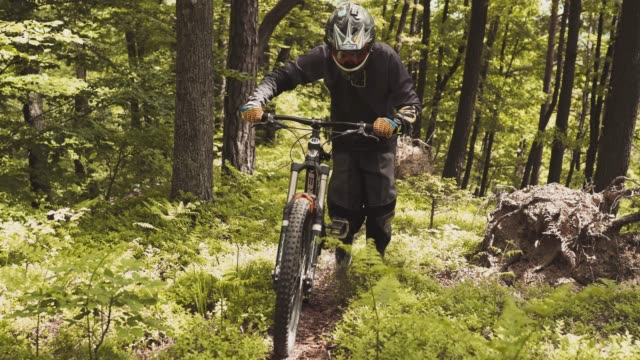 cyclist going up the mountain path - mountain bike stock videos and b-roll footage