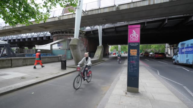 cyclist in central london using the cycle superhighway 3, 7 weeks after the uk government announced a lockdown as restricts start to ease on march... - riding stock videos & royalty-free footage