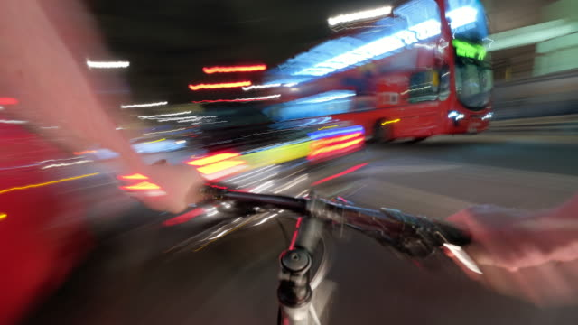 A cyclist POV journey travelling at night rapidly through the West End passing Trafalgar Square then down Westminster towards the Houses of Parliament