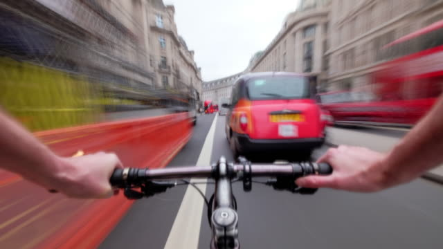 a cyclist pov journey travelling rapidly through central london passing along regent street crossing oxford circus then down towards piccadilly square - passing sport stock videos and b-roll footage