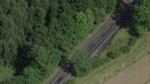 vídeos y material grabado en eventos de stock de cyclist on country road northumberland available in hd. - northumberland