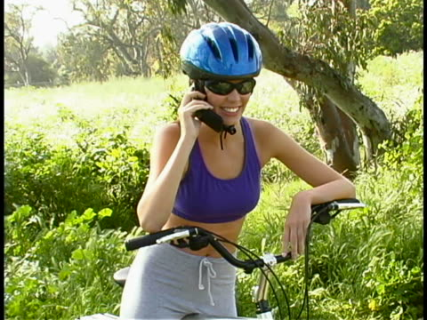 cyclist on mobile phone - three quarter length stock videos & royalty-free footage