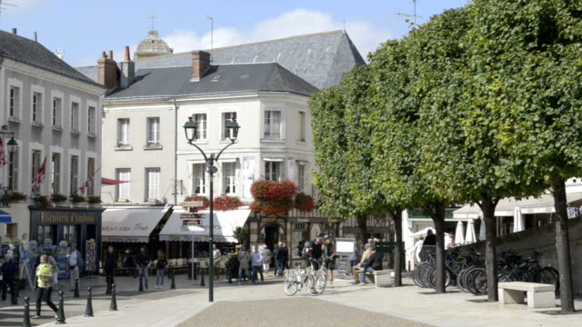 Cyclist on Place Michel Debre, Old town of Amboise
