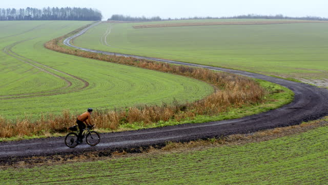 cyclist on rural gravel track - corner stock videos & royalty-free footage