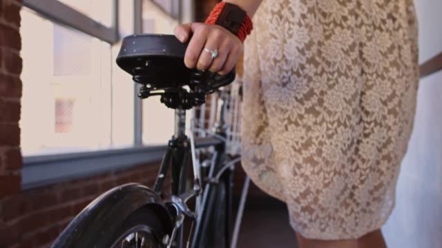 Cyclist Pushing Bicycle Down Hallway