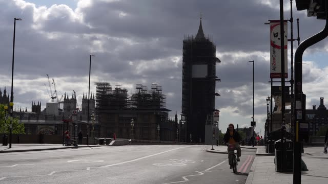 a cyclist rides over and past big ben as they commute in london during the coronavirus covid19 pandemic the prime minister announced the general... - on the move stock videos & royalty-free footage