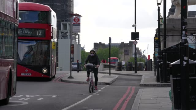 cyclist rides over and past big ben as they commute in london during the coronavirus covid-19 pandemic. the prime minister announced the general... - big ben stock videos & royalty-free footage
